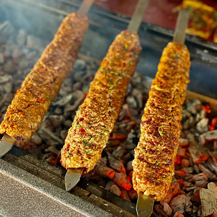 a group of food on a grill