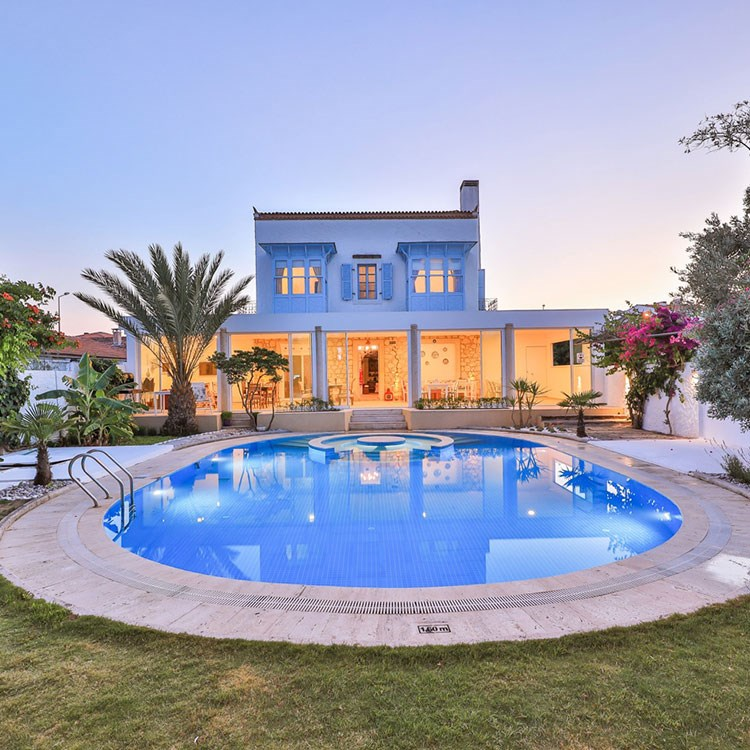 a large house with a pool in front of it