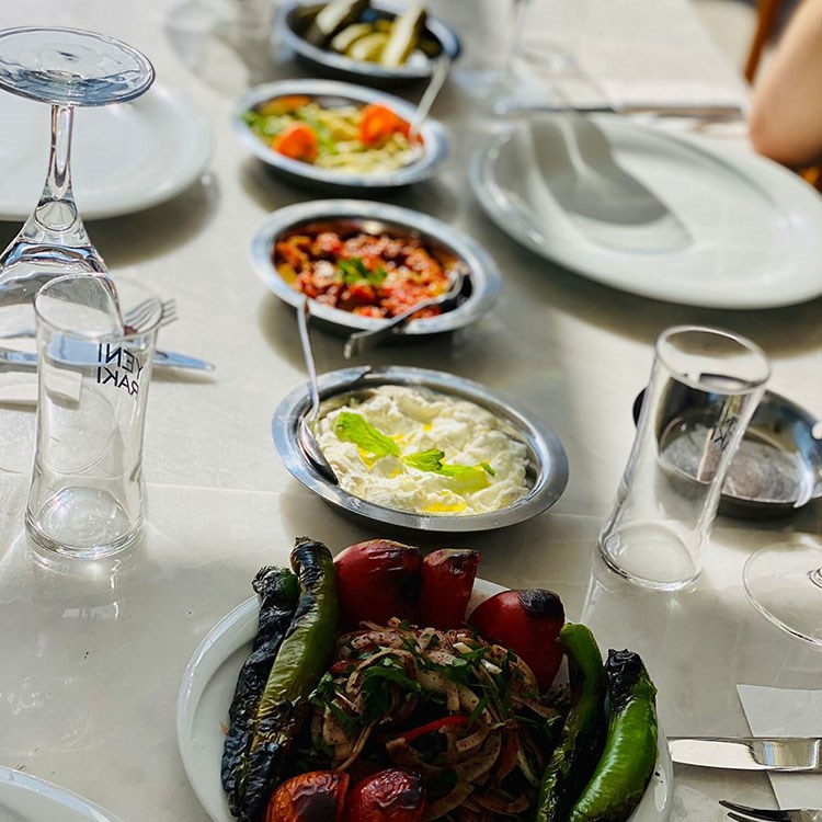 a table with plates of food and glasses