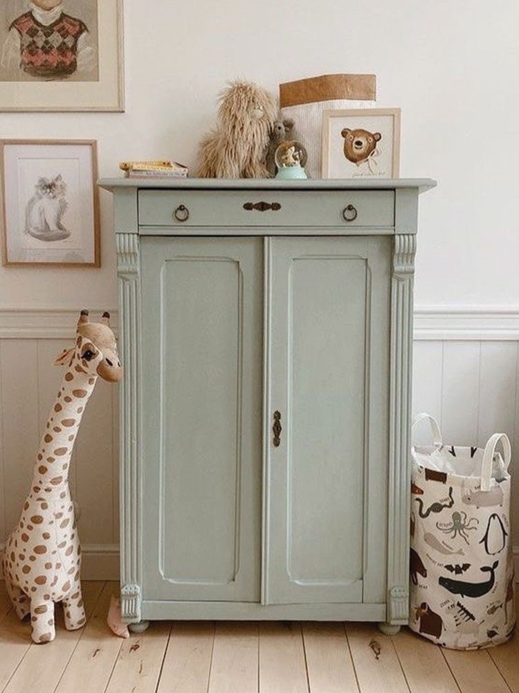 a cabinet with stuffed animals on top