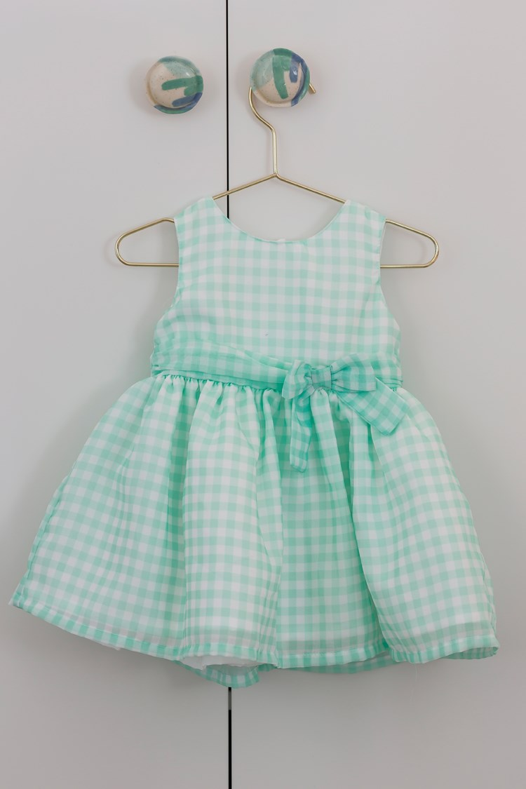 a green and white dress