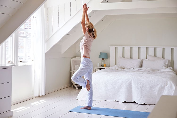 a person standing on a bed