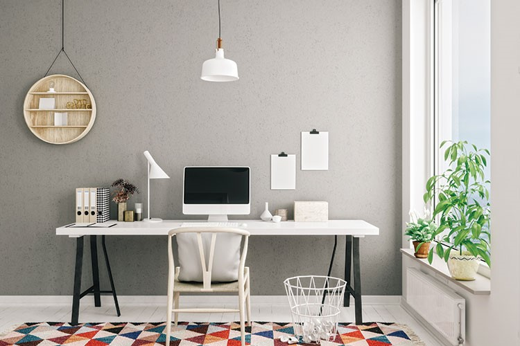 a white desk with a computer on it