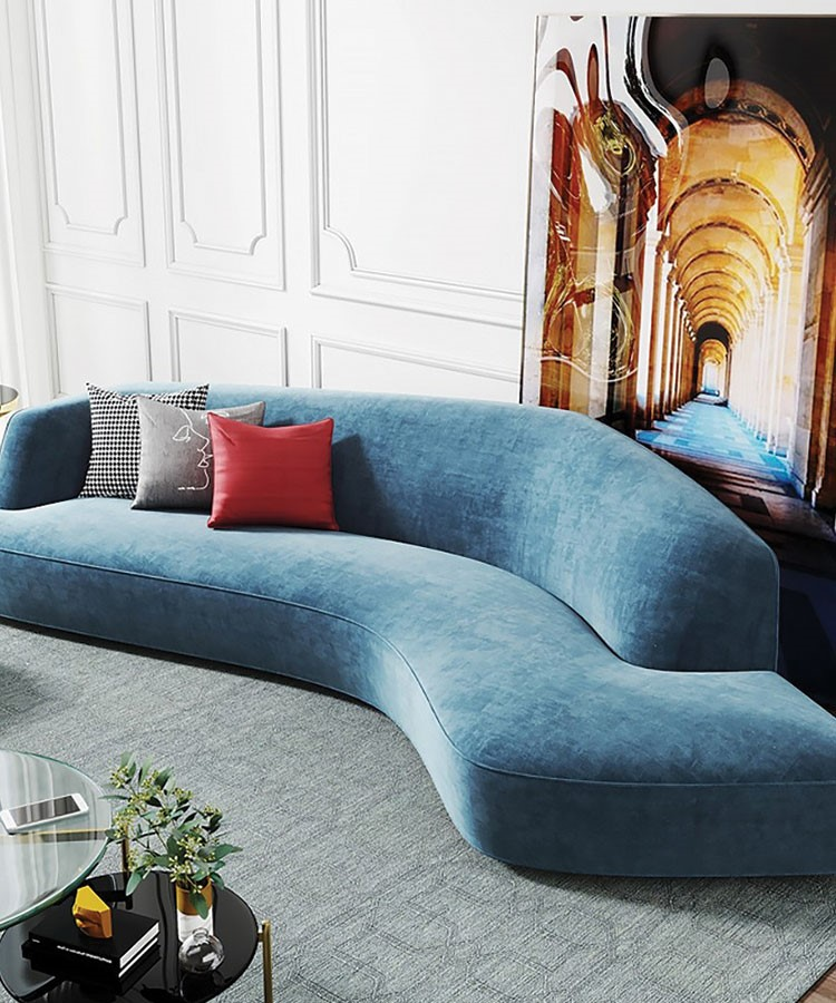 a blue couch with pillows
