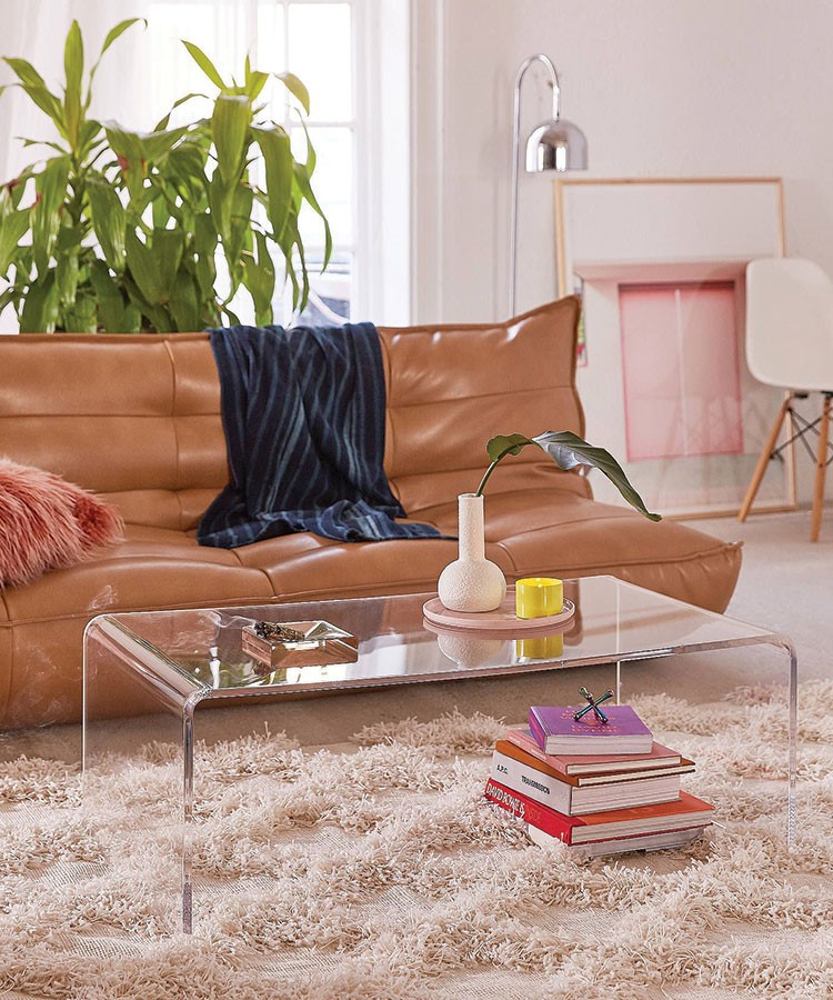 a couch with a coffee table and books on it