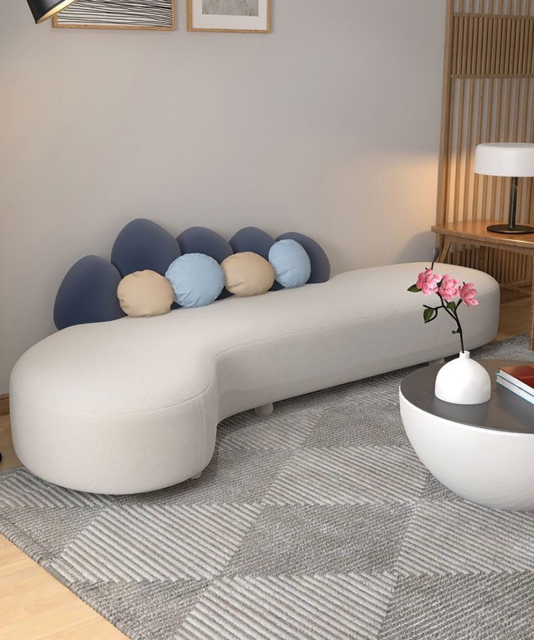 a couch with a white pillow