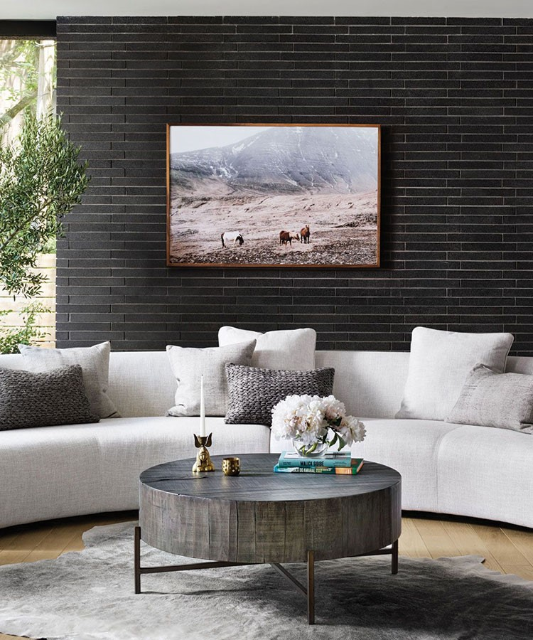 a living room with a large painting