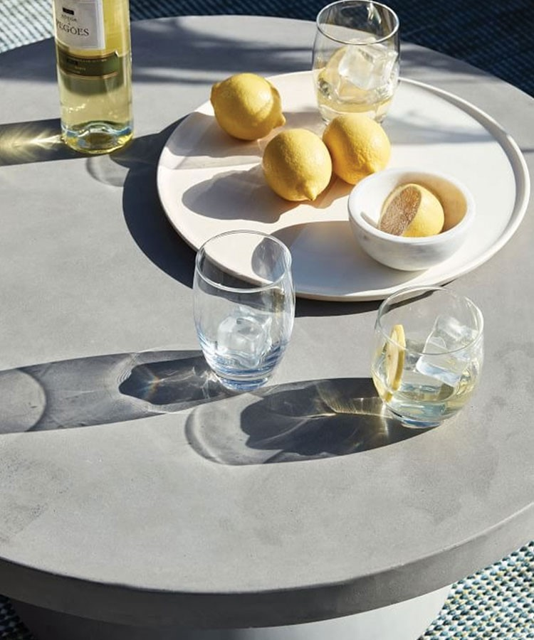 a plate of lemons and glasses on a table