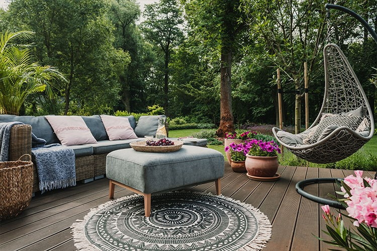 a patio with a couch and chairs