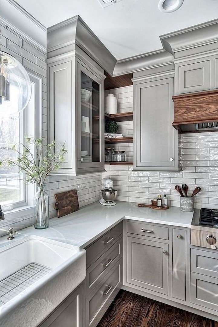 a kitchen with a tub and cabinets