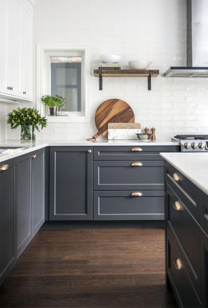 a kitchen with black cabinets