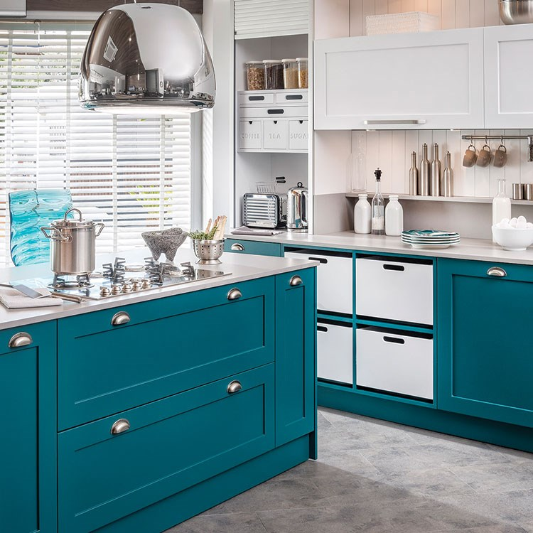a kitchen with blue cabinets