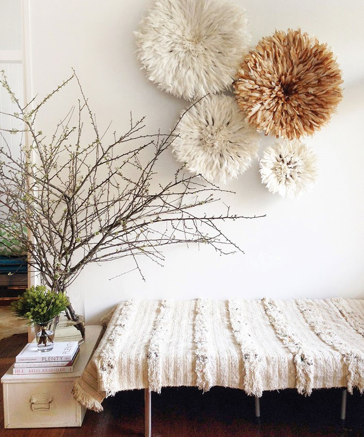 a bed with a tree on the side