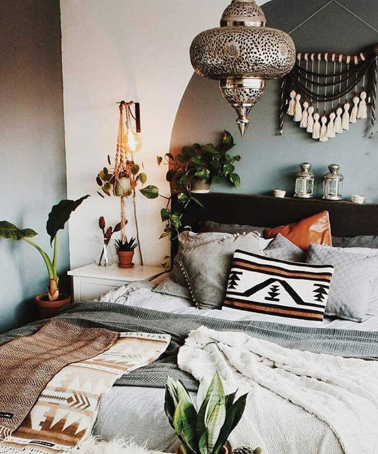 a bed with pillows and a lamp