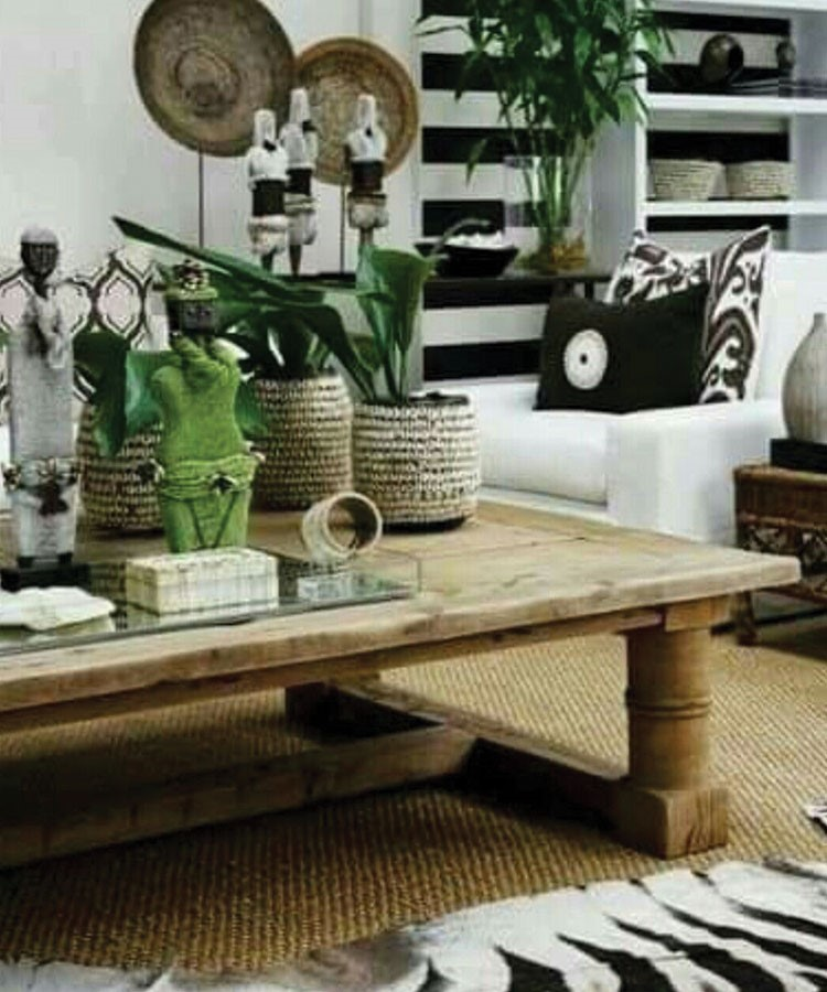 a table with a basket and plants