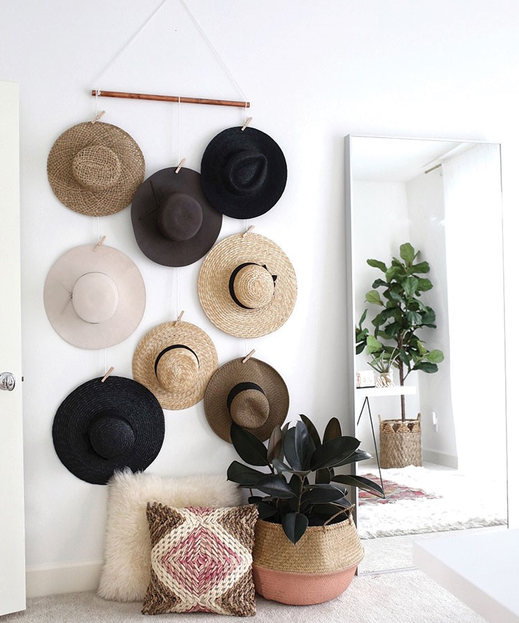 a wall with a variety of hats