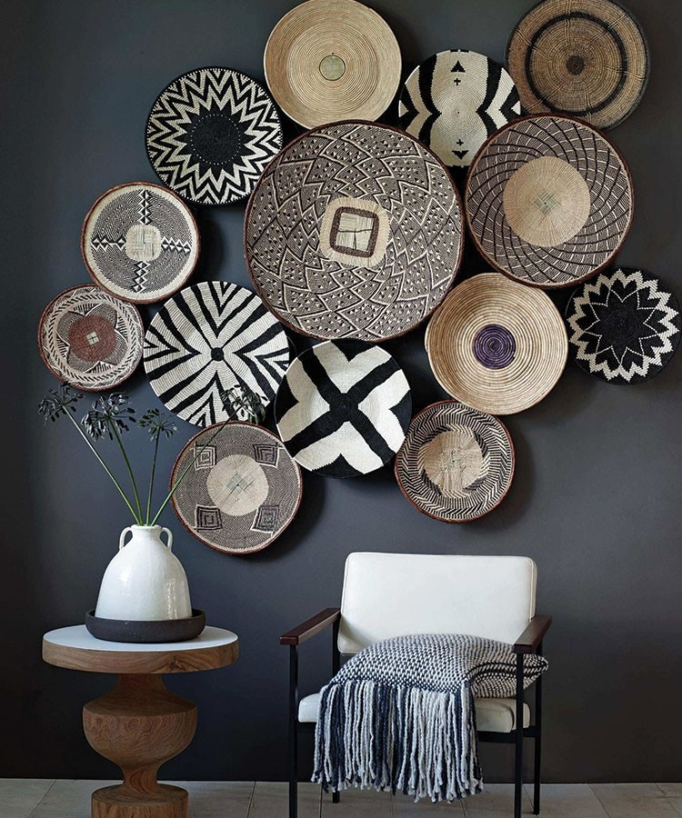 a wall with a vase and plates
