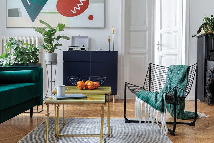 a living room with a table and chairs