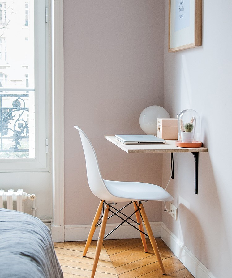 a desk with a chair and a window