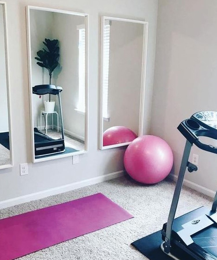 a pink ball on a stand in front of a mirror