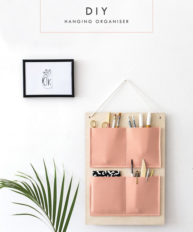 a pink box with a picture of a plant on it