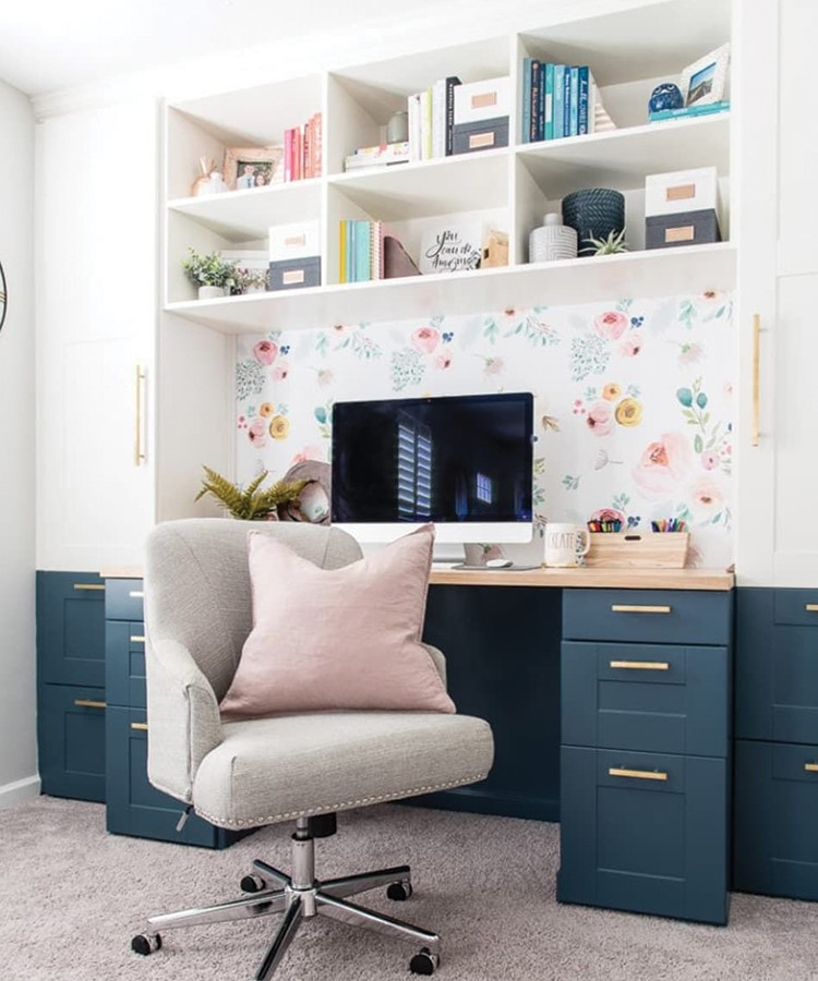 a room with a desk and a computer