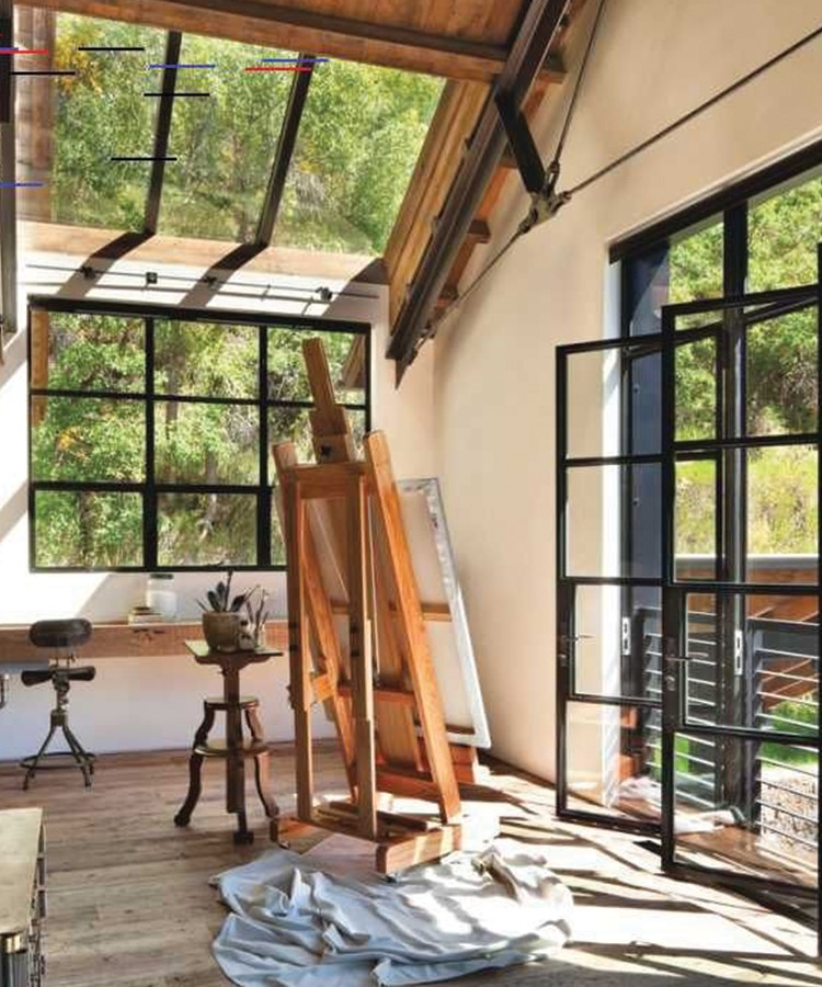 a room with a ladder and windows