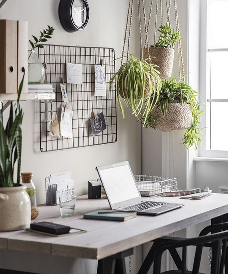 a table with a laptop and plants on it