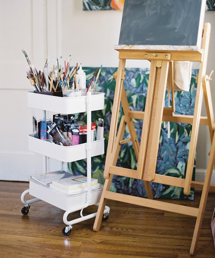 a wooden shelving unit with a painting on it