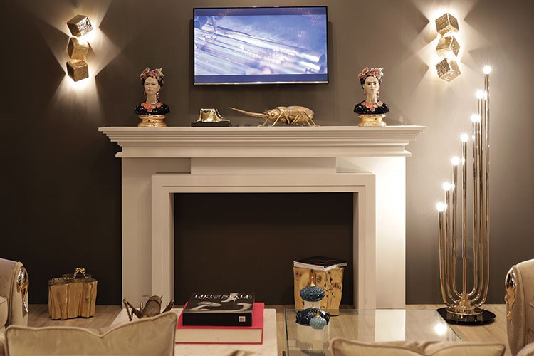 a fireplace with a television and candles