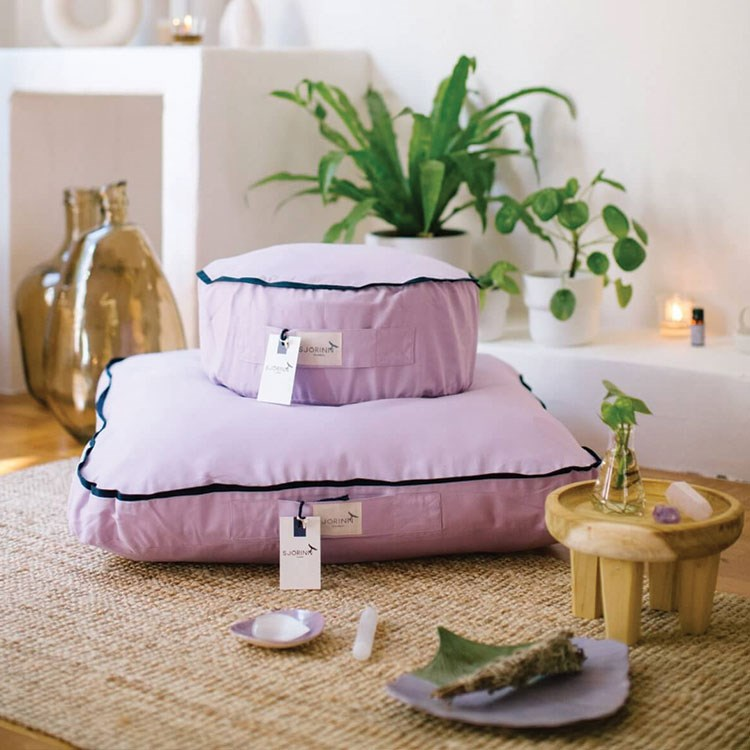 a bed with a pink cover