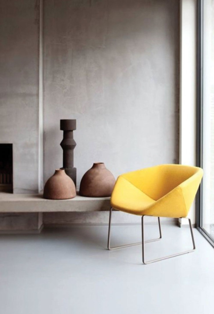 a chair and a vase on a shelf