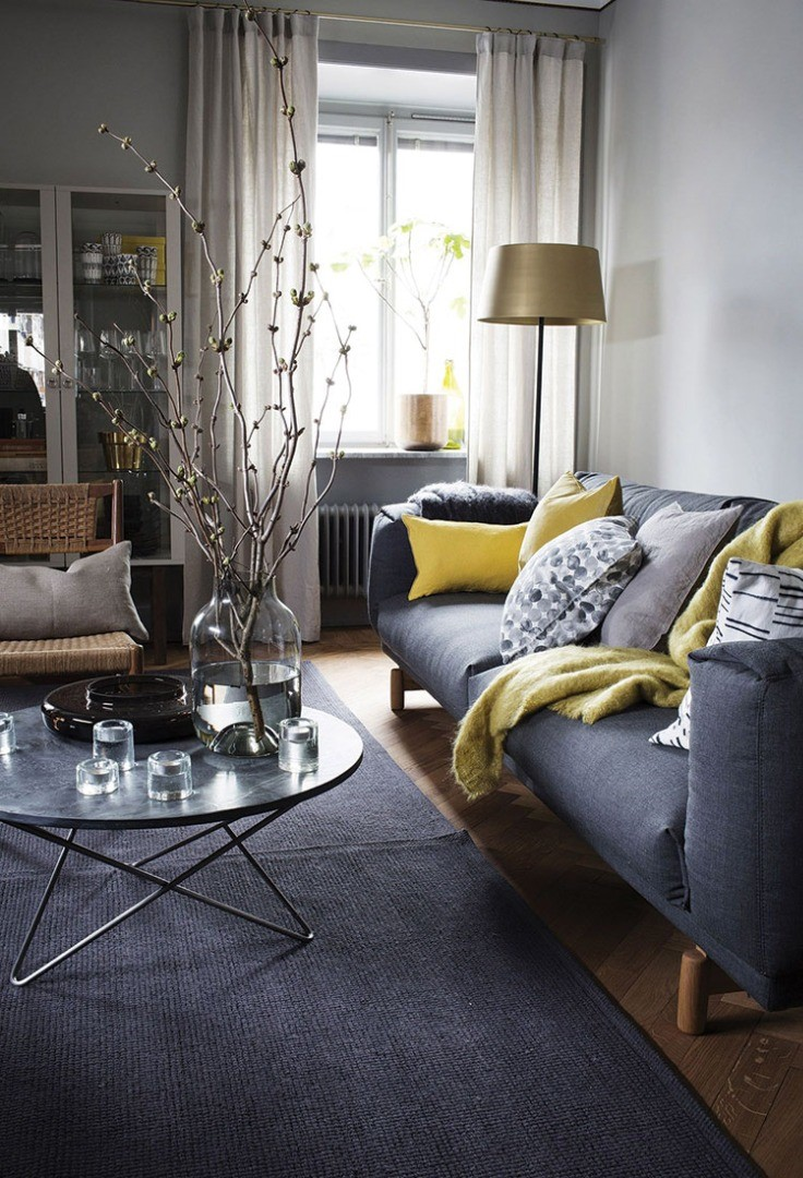 a living room with a couch and coffee table