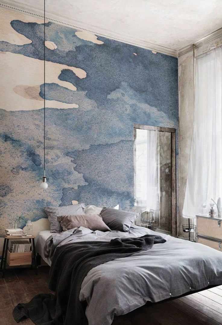 a bedroom with a large blue wall