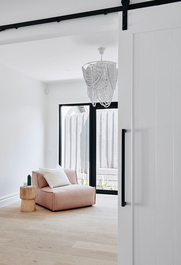 a room with a white wall and a white chair
