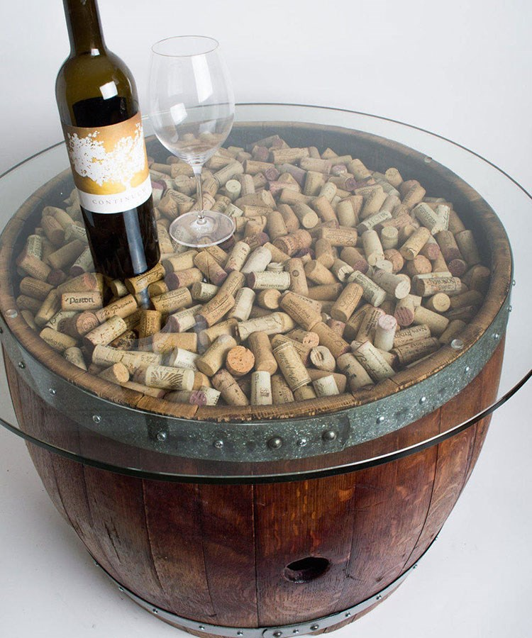 a bowl of nuts and a bottle of wine
