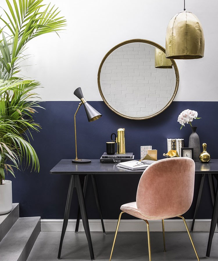 a table with a lamp and a chair in front of it