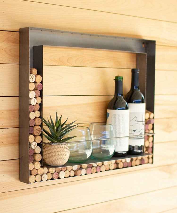 a wooden cabinet with wine bottles and glasses