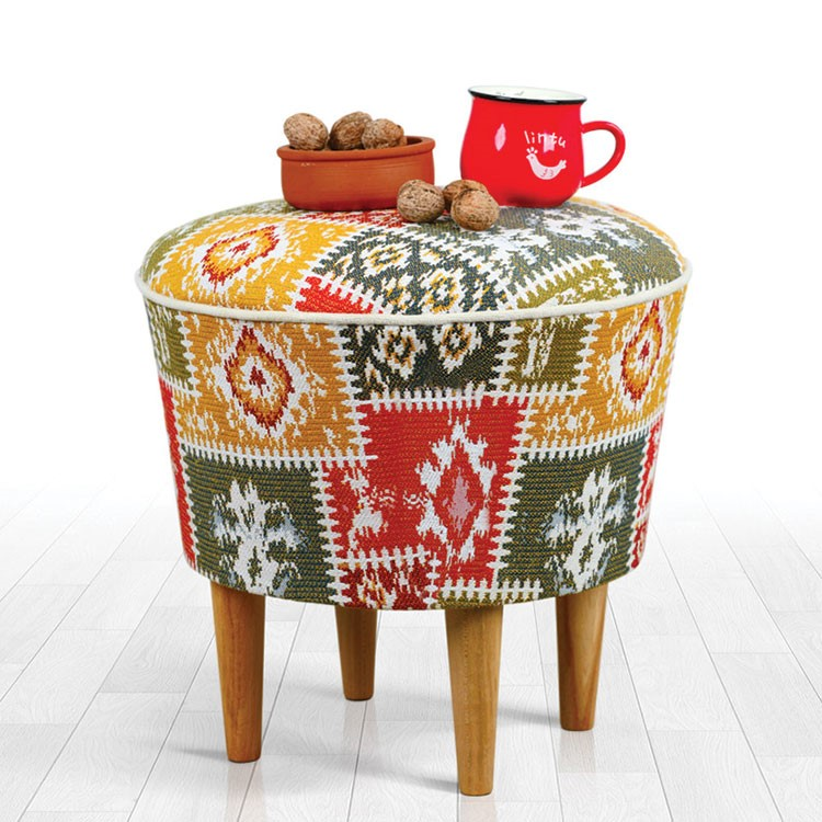 a chair with a pillow and a pot on top