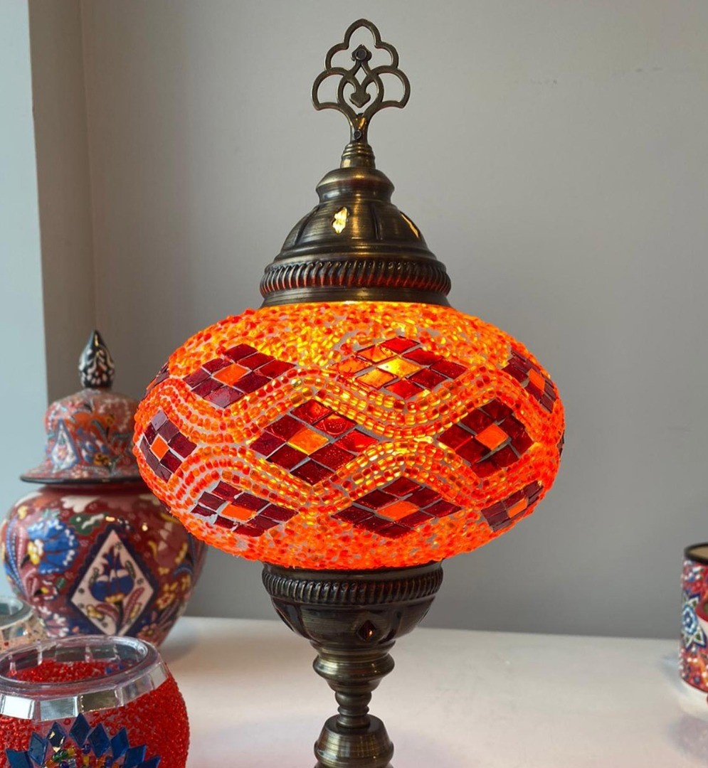 a gold and red lamp