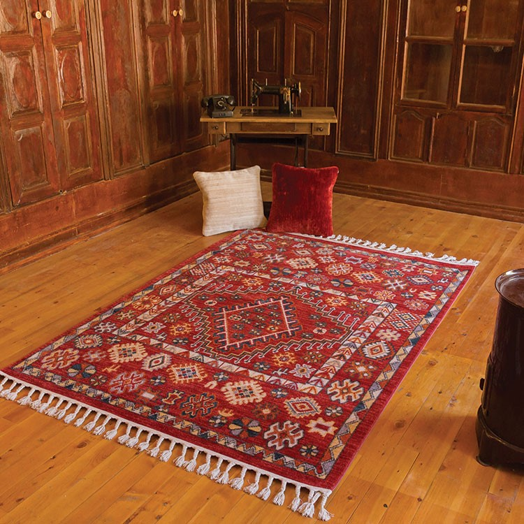 a red and white rug on a wood floor