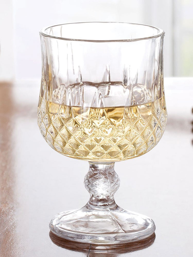 a glass with a liquid in it
