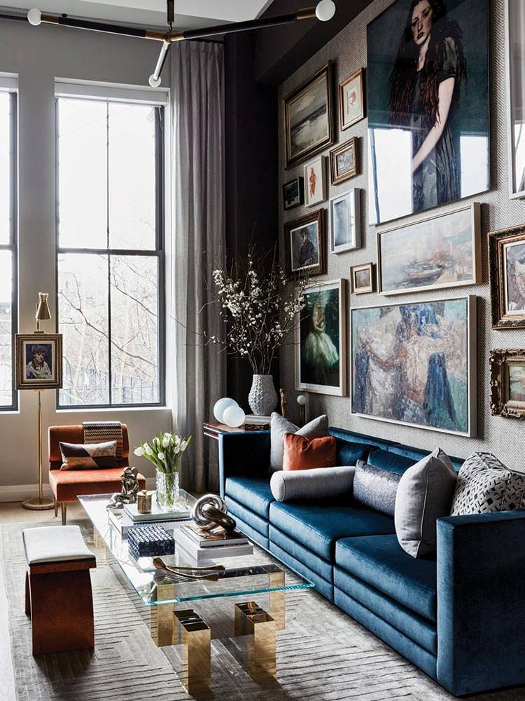 a living room with a blue couch