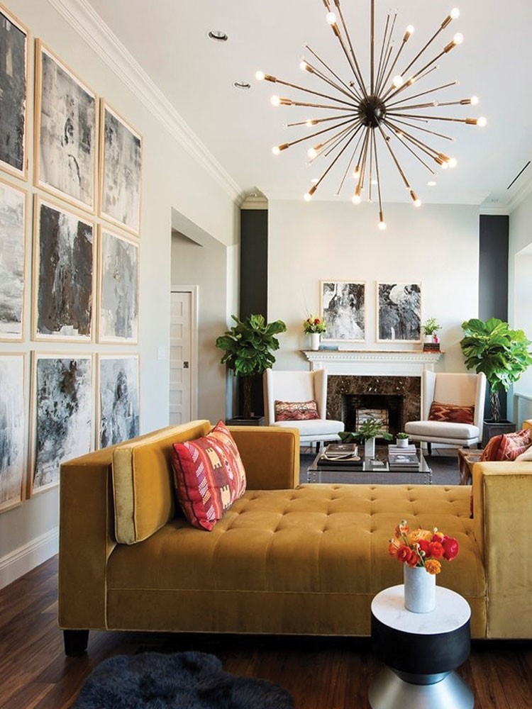 a living room with a chandelier and a couch