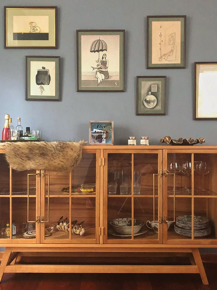 a room with a shelf with objects on it