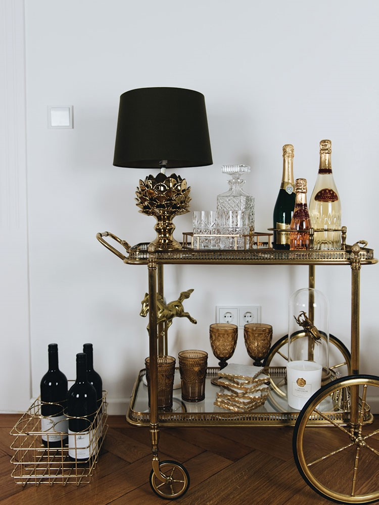 a table with a lamp and bottles on it
