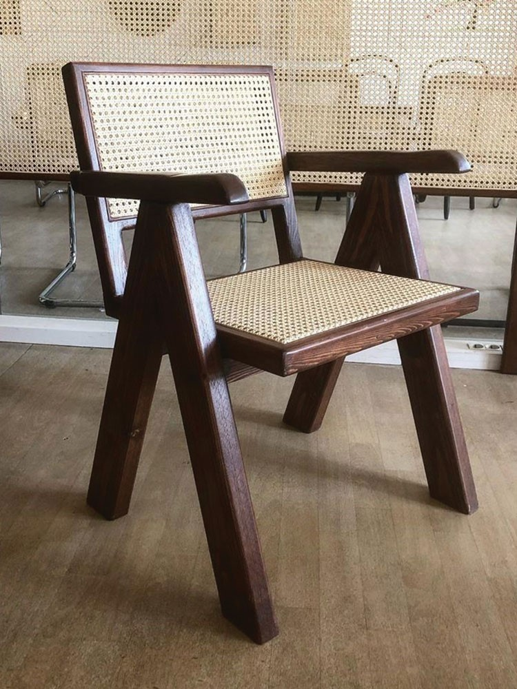a wooden chair in a room