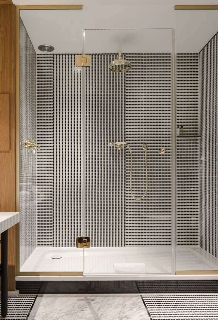 a bathroom with a shower unit