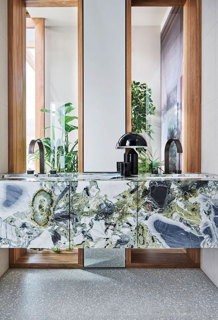 a large glass bathroom with a marble countertop