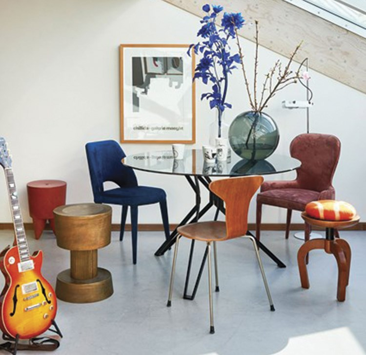 a table with chairs and a guitar